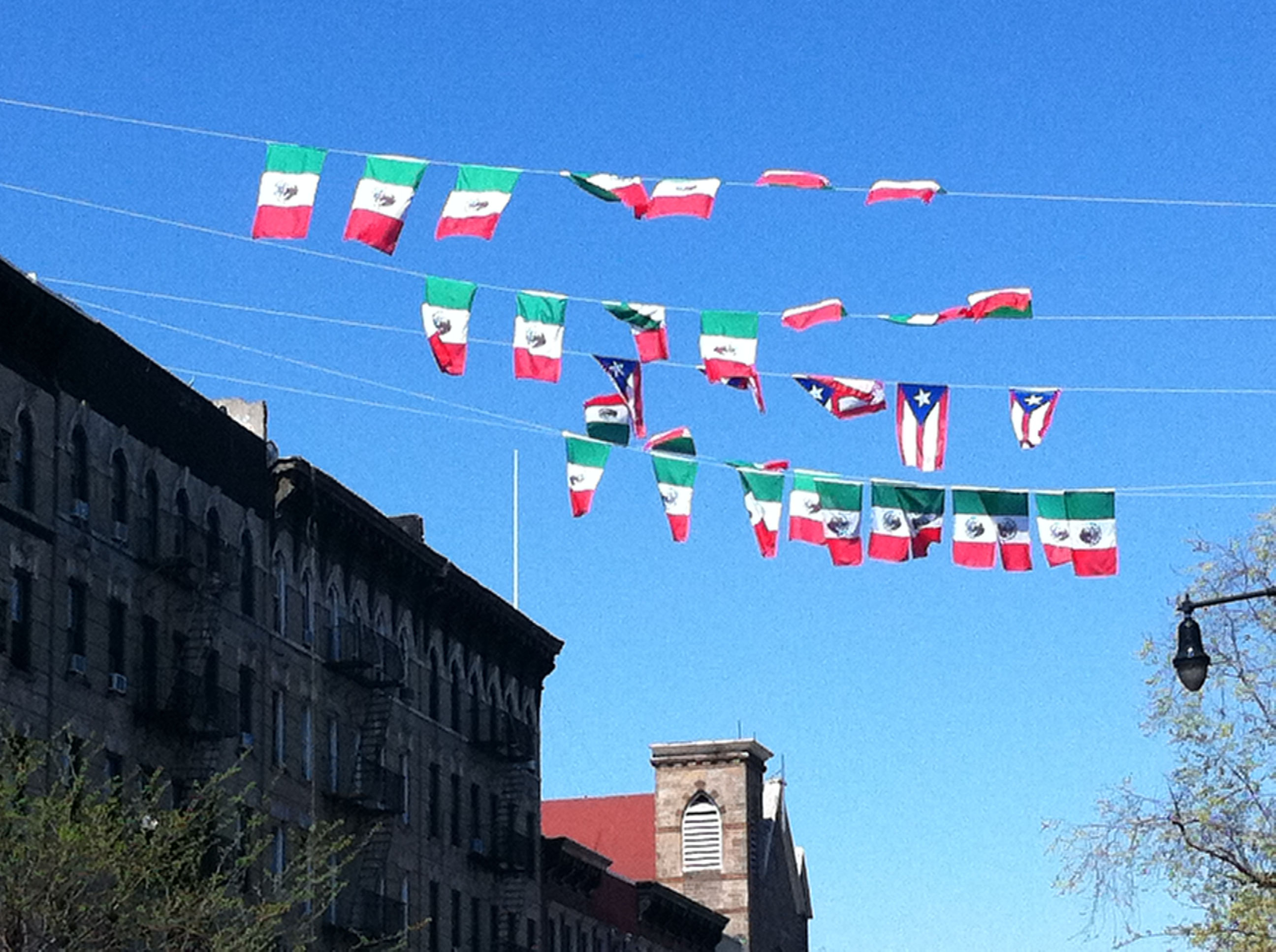 Flags on E. 116th by E. Mayorga